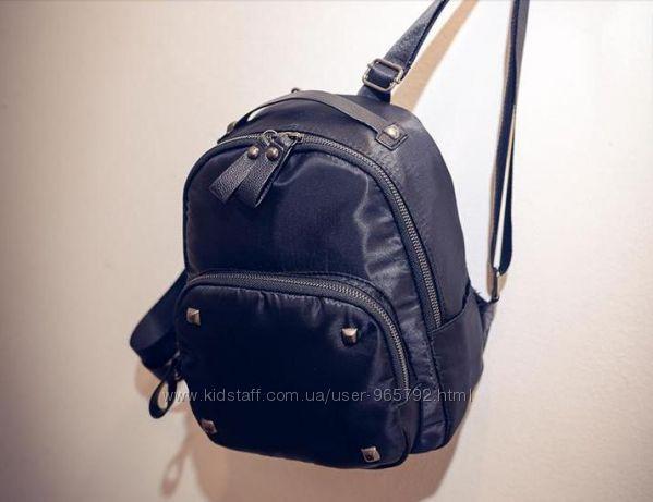 Стильный рюкзак с заклепками с кожаной фурнитурой