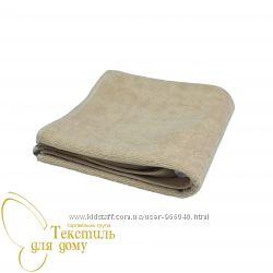 бежевое махровое  полотенце