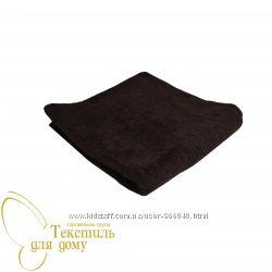 коричневое махровое полотенце