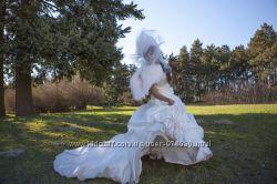 Дизайнерское платье со шлейфом