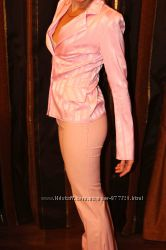 Продам розовый комплект брюкипиджак размер 42.
