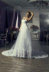 Продам шикарное фирменное свадебное платье. Размер С   42