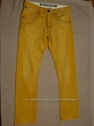 Эффектные хб джинсы -варенки цвета охры с потертостями One Green Elephant