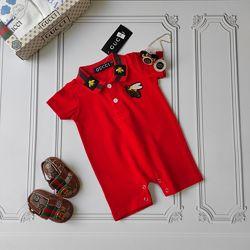 Красный песочник Gucci для новорождённого.