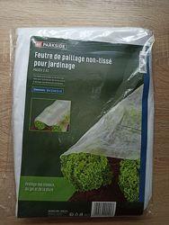 Садовий фліс для захисту грядок та молодих рослин