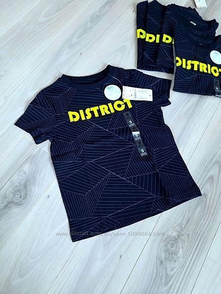 Kiabi футболка 6 и 8 лет с неоновой надписью district