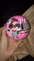 L. O. L. Surprise Lights Glitter Doll with 8 Surprises Including Black Light
