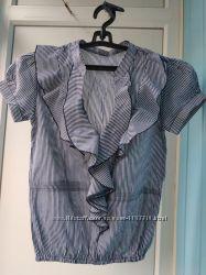 Блуза в полоску.