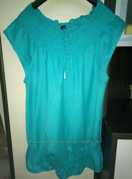 Стильная , яркая блуза с разрезом по спине