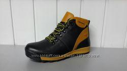 Подростковые черно-желтые зимние ботинки Timberland.