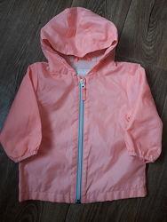 Ветровка оранжева , курточка фірми Next. Розмір 9-12m. ,більшомірить.