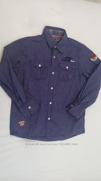 Рубашка  REBELрукав трансформируется. На спине принт - 8 - 10 лет .
