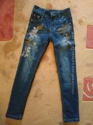 Джинсы YukeТурция  для девочки синего цвета