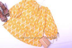 Яркая солнечная блуза в трендовый принт листики шведского бренда H&M