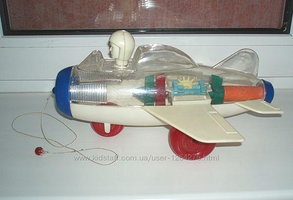 Игрушка механическая самолёт - каталка СССР винтаж клеймо цена