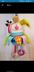 Развивующая игрушка мальчик Куки на клипсе