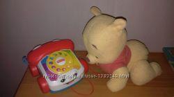 Игрушки для малыша.  Телефон каталка и винни пух ползает