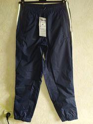 Новые спортивные дождевые брюки Crane - р. M 40-42евро