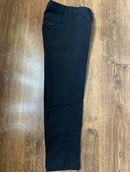 Продам школьные строгие брюки Next на возраст 9-11 лет.